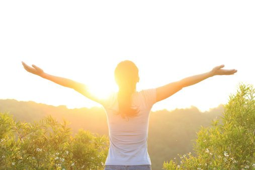 woman excited with sunrise