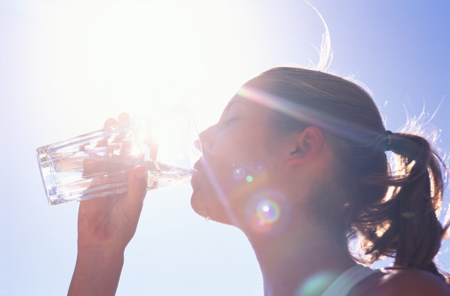 WOMAN DRINKING WATER, CLOSE UP