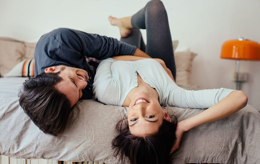 couple-bed-laughing