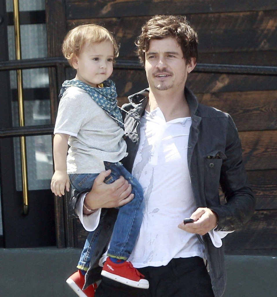 Exclusive... 51081577 'Zulu' actor and proud father Orlando Bloom takes his growing baby boy Flynn out for lunch and then for clothing fitting in Los Angeles, California on April 28, 2013. Bloom was a doting parent to his two year old, patiently waiting when Flynn refused to let go of the railing outside the restaurant. Later, Flynn playfully patted his dad's belly while he tried on shirts at a store. FameFlynet, Inc - Beverly Hills, CA, USA - +1 (818) 307-4813