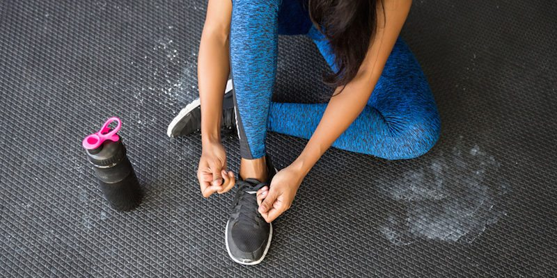 girl-tying-her-shoe-get-to-gym