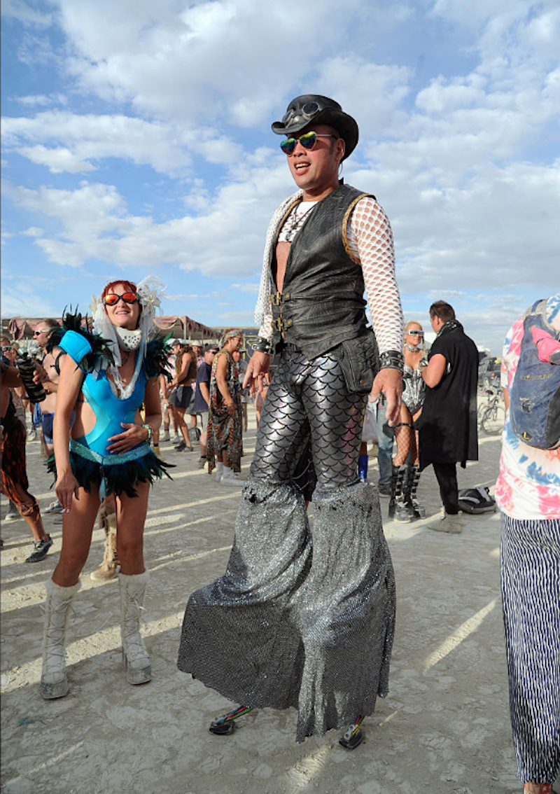 burners-who-wanted-even-more-height-brought-stilts-and-pants-long-enough-to-cover-them