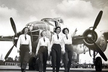 16 July 2009    From the left, Dorothy Dodd Eppstein, Hellen Skjersaa Hansen, Doris Burmester Nathan and Elizabeth Chadwick Dressler, walk in front of a B-25 plane, as they were Air Force engineering test pilots for the B-25 during World War II.     Shawano Cleary / Special to the Gazette