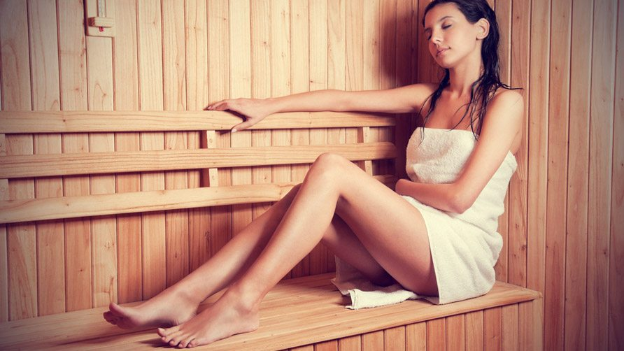 young-woman-relaxing-in-a-sauna-cover