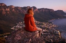 800x400-woman-sitting-cliff-overlooking-city