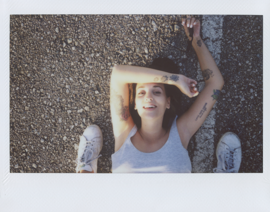 overhead: photographer shooting young woman