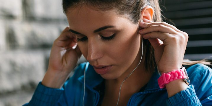 woman-putting-in-headphones-workout